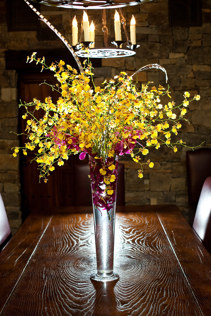 Wedding floral san martin yellow orchids centerpieces
