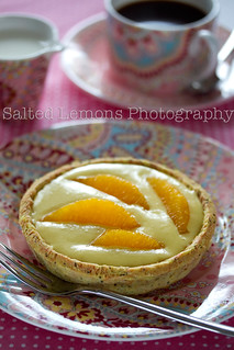 Tartalette with orange-mango curd and orange wedges | by lois slokoski