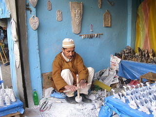 man carving at a trail-side shop | by goat&squirrel