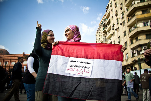 Women in Hijab Hold Egyptian Flag | by On Being