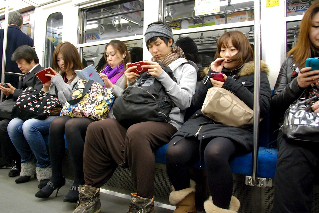 Texting On The Train People In Tokyo Pass The Time On