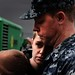 Sailor hugs his family before deploying to support efforts off the coast of Libya.