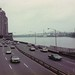 FDR Expressway, the East River, Triboro Bridge, Hell Gate Bridge. Is that Theo Kojak driving one of these 70s beauties? Hey, who loves ya, baby! New York. March  1975