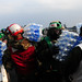 Sailors carry water to helos for disaster relief efforts in Japan.