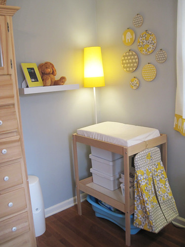 changing table corner with new shelves, yellow ikea lamp ...