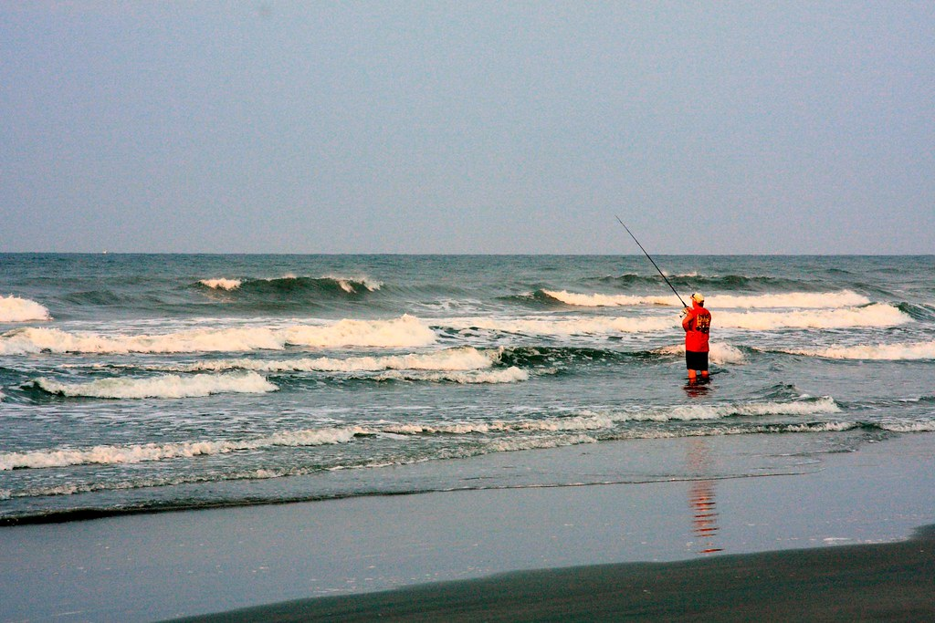 Surf fishing in the early morning sunrise at sunset beach for Nc surf fishing report