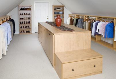A custom closet above the garage taking advantage of for Closet world garage