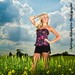 [EXPLORED] blonde model in wheat field with clouds