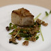 Crispy pork belly with a salad of grilled ramps, peas, and farro drizzled with bacon agrodolce