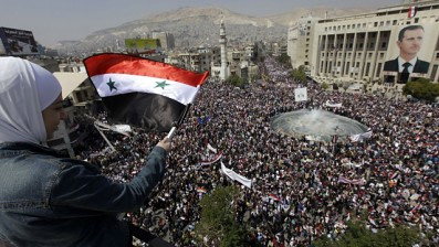 Large demonstrations in support of the Syrian government of President Bashar Al-Assad in Damascus, the capital, on March 29, 2011. The president addressed parliament on March 30 and denounced the foreign plot against the country. | by Pan-African News Wire File Photos