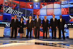 Debate participants arrive on stage