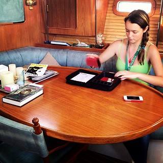 Playing Yahtzee on my dad's boat. I totally kicked ass. THREE Yhatzee's! | by antigone78