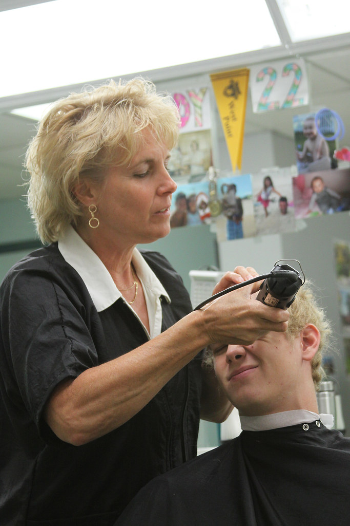R Day Class of 2015   Barber Cindy DeMaro cuts a new cadet ...
