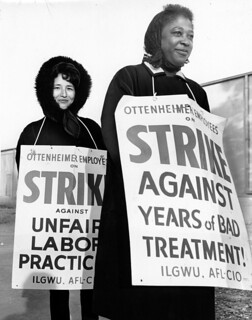 An Asian American and an African American woman wear signs that indicate that they are on strike against Ottenheimer for poor treatment and unfair labor practices, December 1, 1966. | by Kheel Center, Cornell University