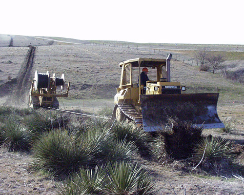 Laying cable to bring broadband to rural communities.