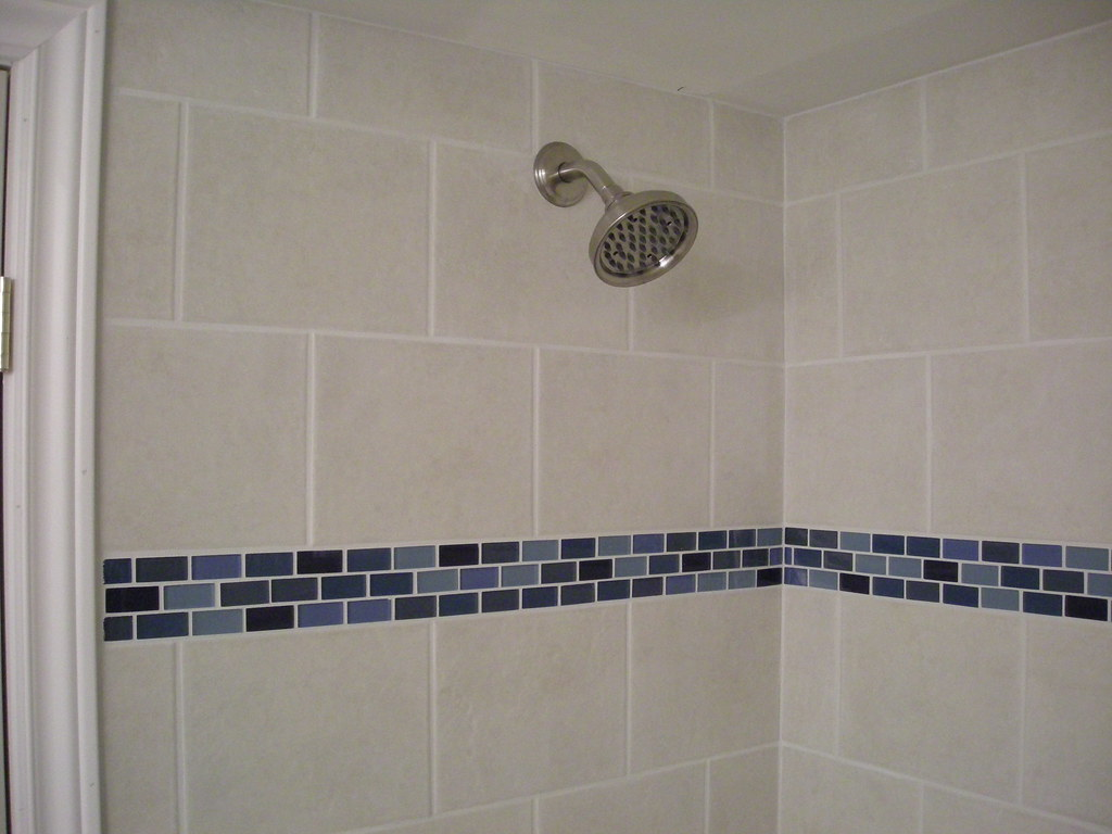 Ceramic tile shower stall with glass border detail flickr for Glass tile border bathroom ideas