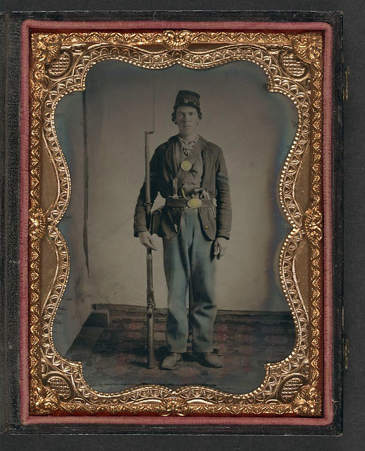 [Unidentified Young Soldier In Union Uniform On Rug With