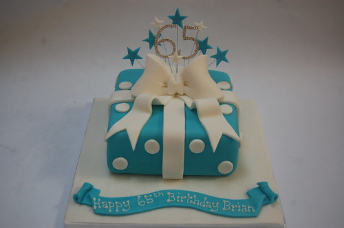 Sometimes it's hard to come up with an idea for a cake for a man, but we thought this fitted the bill superbly! The Blue Polka Dot Present Cake - from £50.