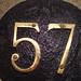 No 57 - brass on black