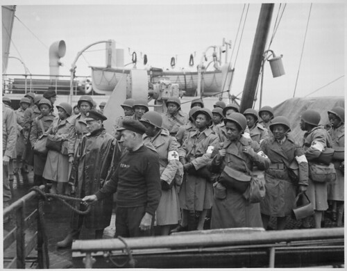 U.S. Army nurses, newly arrived, line the rail of their vessel as it pulls into port of Greenock, Scotland, in European Theater of Operations. | by The U.S. National Archives