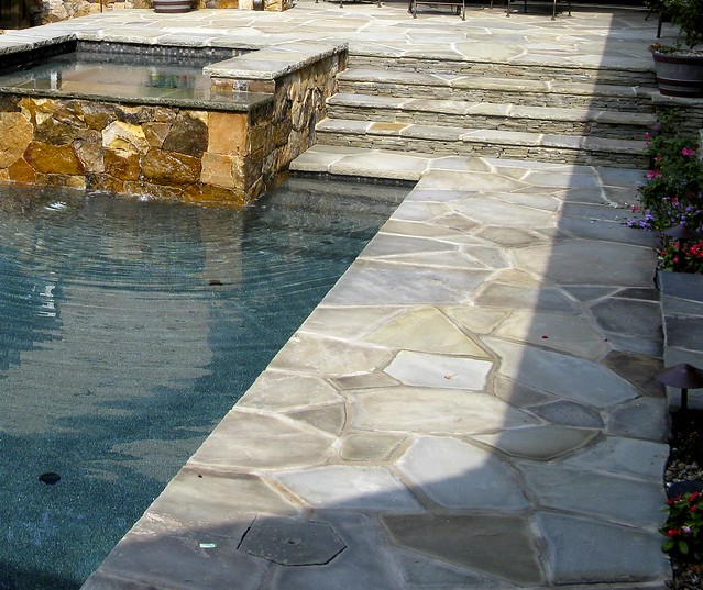 Natural stone swimming pool patio raleigh swimming pool for Pool design raleigh nc
