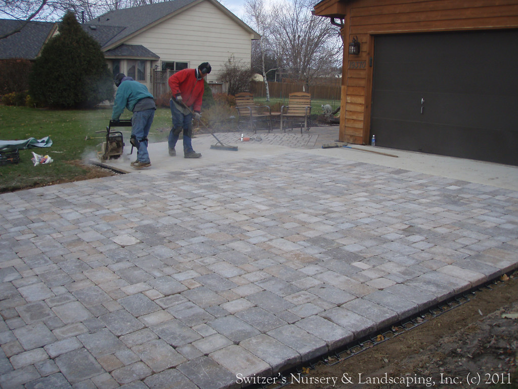 Interlocking concrete paver driveway installing polymeri for Installing patio pavers on sand