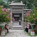 Family of Hui Chinese enjoying the garden inside Xi'an Great Mosque