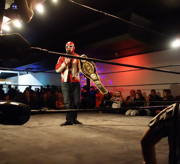 Wild Machine holds up title belt at the end of Socktoberfest