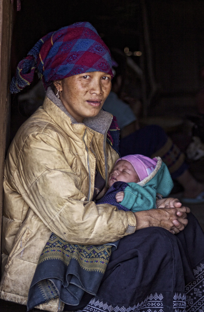 A Hmong Lady Cradles Her Baby
