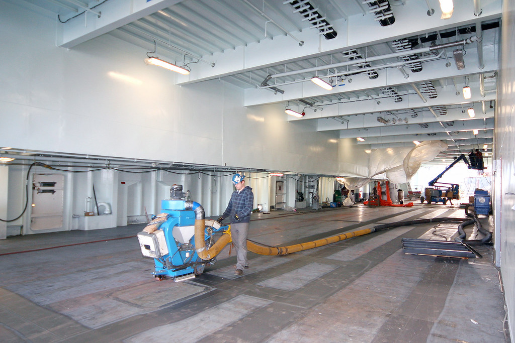 Preparing steel for paint on vehicle deck at everett for How to prepare metal for painting