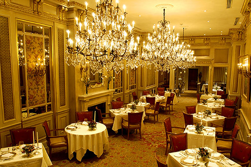 French restaurant interior chandeliers maybe one in