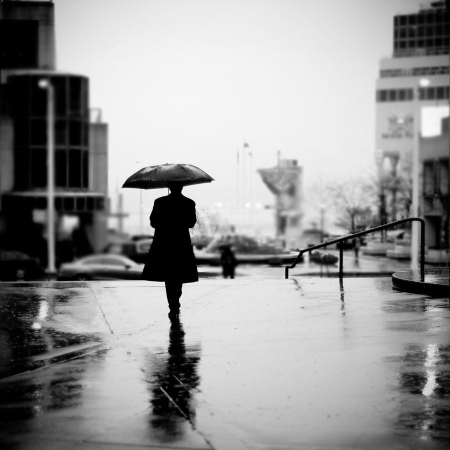Sad person in rain
