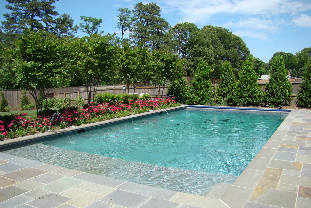Tanning ledge swimming pool elite pools flickr for Pool design with tanning ledge