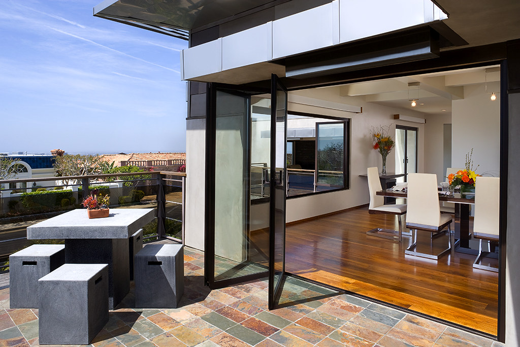 Nanawall newport beach house nanawall for Modern glass pocket doors