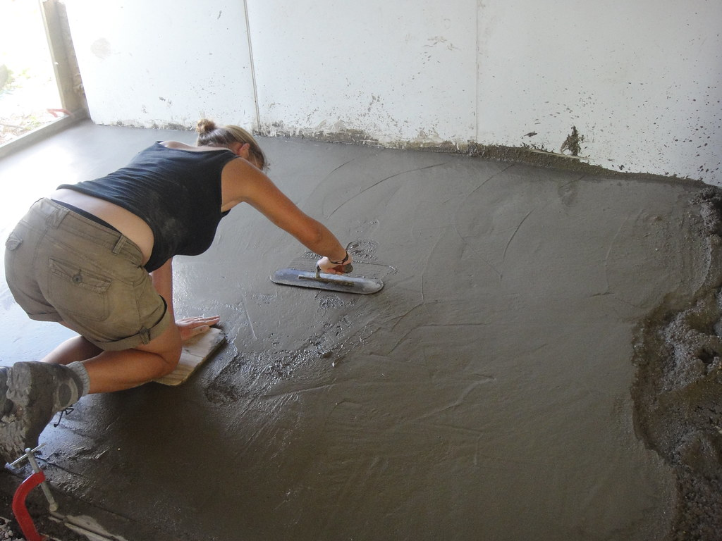 creating a smooth finish on the new concrete floor for the. Black Bedroom Furniture Sets. Home Design Ideas