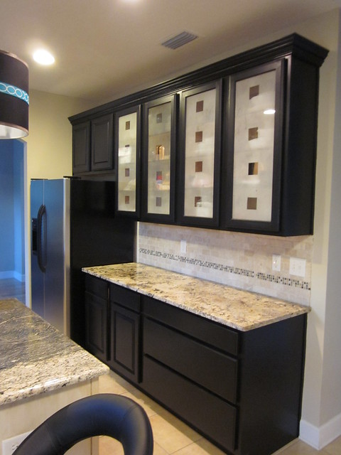 Photo for Black kitchen cabinets with glass doors