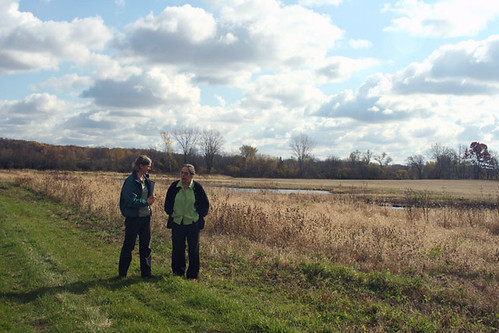 Left to right: NRCS biologist Kristin Westad visiting the wetland restoration area with landowner Elsbeth Fuchs on her Wisconsin farm