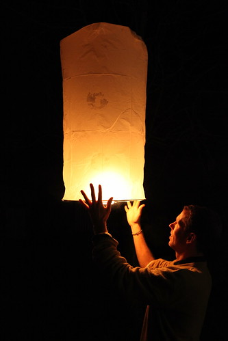 Playing with a sky lantern | by Alexandre Dulaunoy