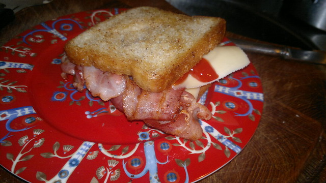 Bacon and cheese butty in fried bread