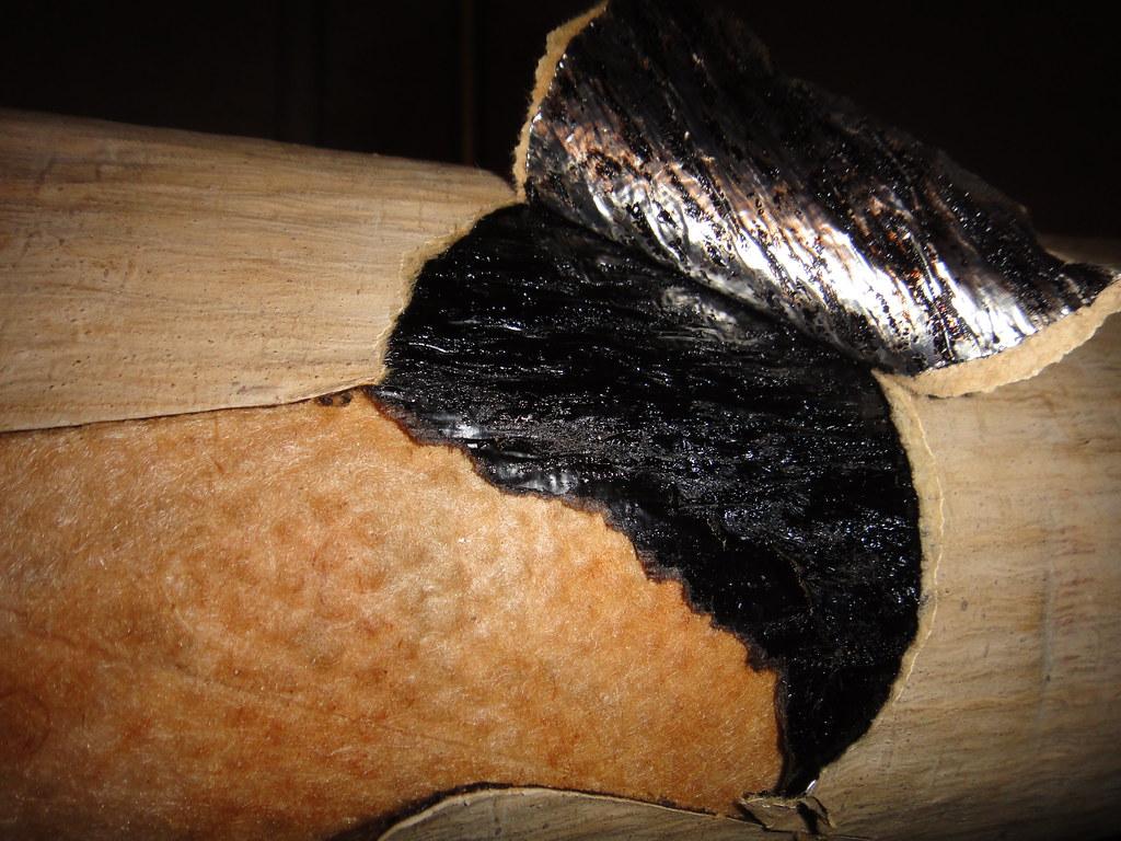 Asbestos coating on fiberglass pipe insulation section for Fiberglass insulator