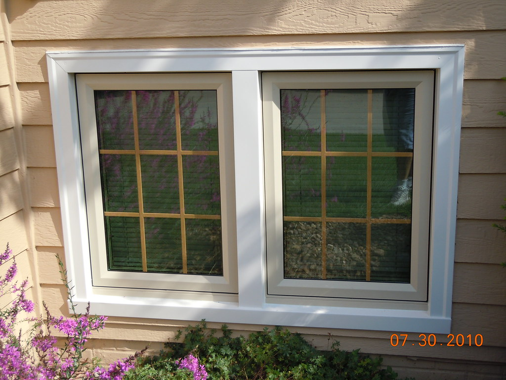 Sunrise casement window with linen trim casement windows for Window vinyl design