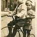 Two boys on a tricycle (1904-1918)