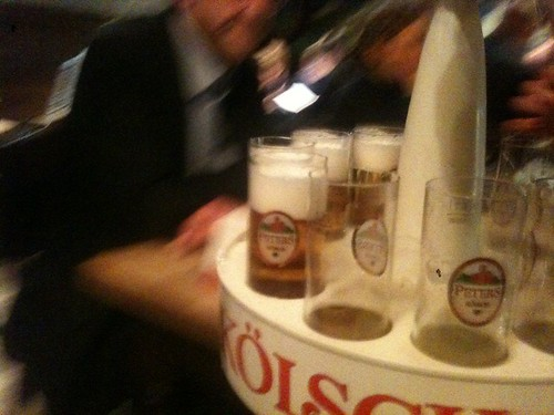 Giant trays of Kolsch swinging between the tables. | by benjilanyado
