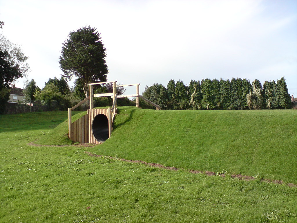 Long grass mound with tunnel jane bain flickr for Mounding grass