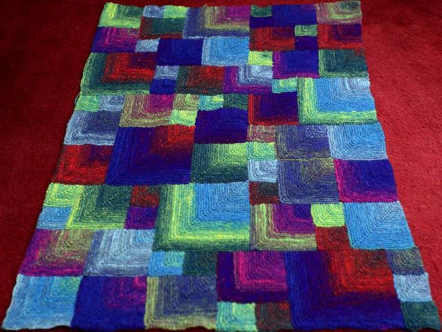 Improvised mitred garter squares blanket in Noro Kureyon Sock