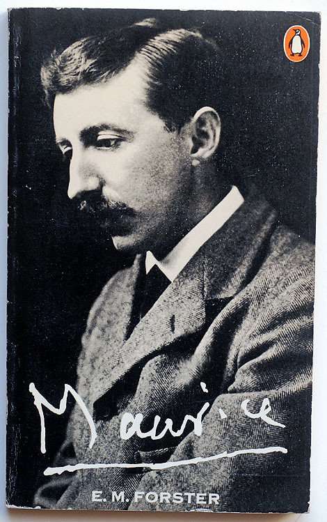 It shows EM Forster looking sad, he is in a tweed suit with a moustache, well-groomed