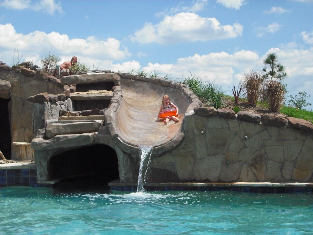 elite pools and spas giant water slide her face says it al u2026 flickr