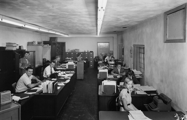Employees Working In The Accounting Office Of Clark Cable
