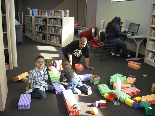 Family in the Kids area at Anythink Washington Street | by Colorado Library blog