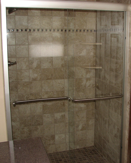 ceramic tile shower with mosaic border and marble corner. Black Bedroom Furniture Sets. Home Design Ideas